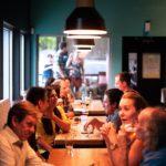 Meteorite Club Meeting Members sit around restaurant table